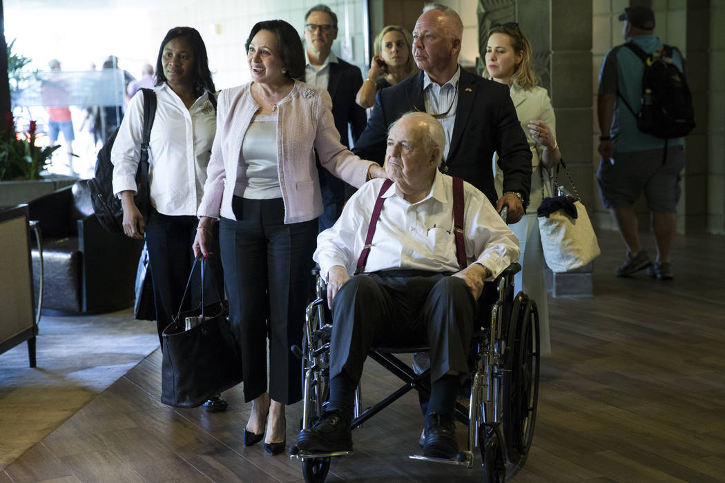 New Orleans Saints owner Tom Benson, center, with his wife Gayle, left, arrive to the NFL Annual Meeting at the Arizona Biltmore Hotel on Sunday, March 26, 2017, in Phoenix, Ariz. (Erik Verduzco/L ...