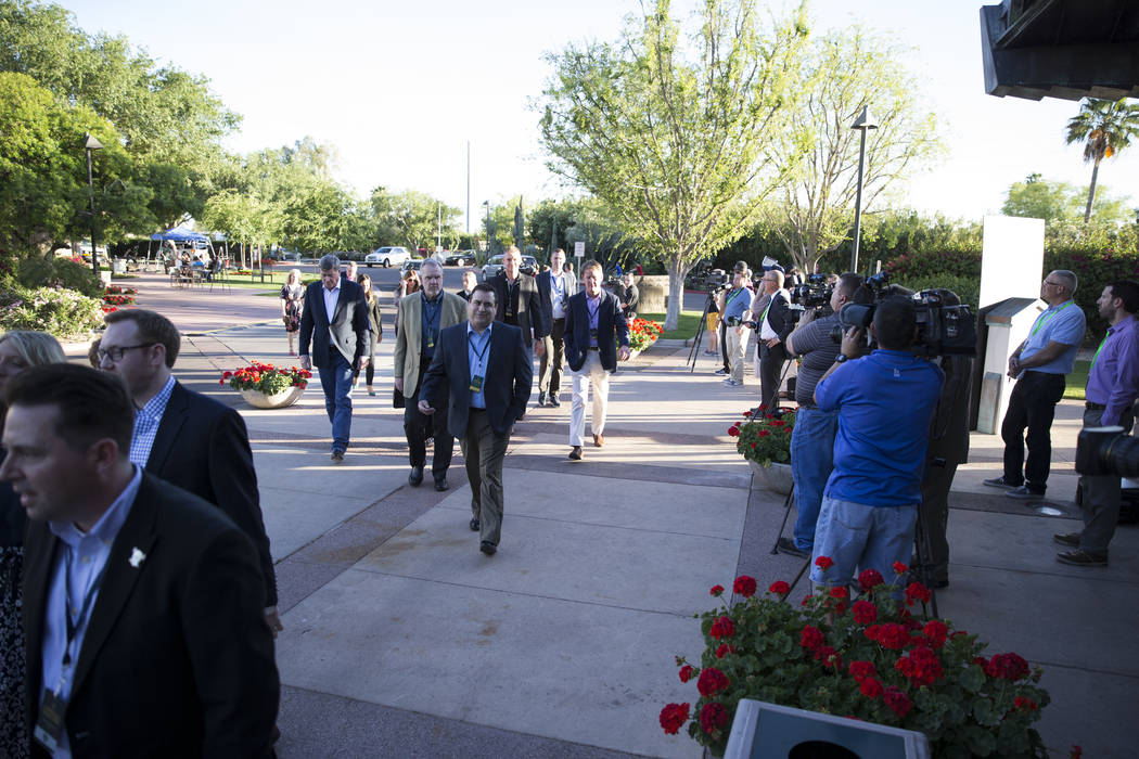 Football teams staff members make their way to a meeting during day one of the NFL Annual Meeting at the Arizona Biltmore Hotel on Sunday, March 26, 2017, in Phoenix, Ariz. (Erik Verduzco/Las Vega ...