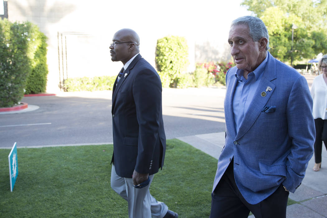 Atlanta Falcons owner Arthur Blank, right, during day one of the NFL Annual Meeting at the Arizona Biltmore Hotel on Sunday, March 26, 2017, in Phoenix, Ariz. (Erik Verduzco/Las Vegas Review-Journ ...