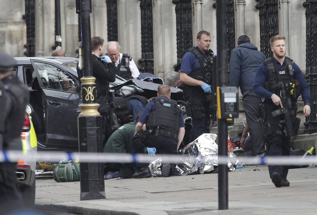 Emergency personnel tend to an injured person outside Britain's Parliament March 22, 2017, after an attack by a British-born man. The attack was claimed by the Islamic State group, which is encour ...
