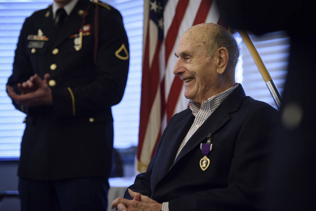 Oscar Davis Jr., a 92-year-old World War II veteran who served with the 1st Battalion, 505th Parachute Infantry Regiment, smiles on Saturday, March 25, 2017, after being awarded a Purple Heart med ...