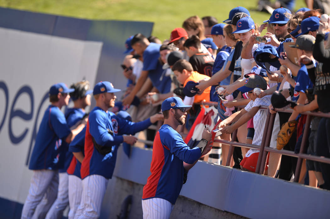 Chicago Cubs players sign autographs before a game between the Chicago Cubs and the Cincinnati Reds at Cashman Field in Las Vegas on Sunday, March 26, 2017. (Brett Le Blanc/Las Vegas Review-Journa ...