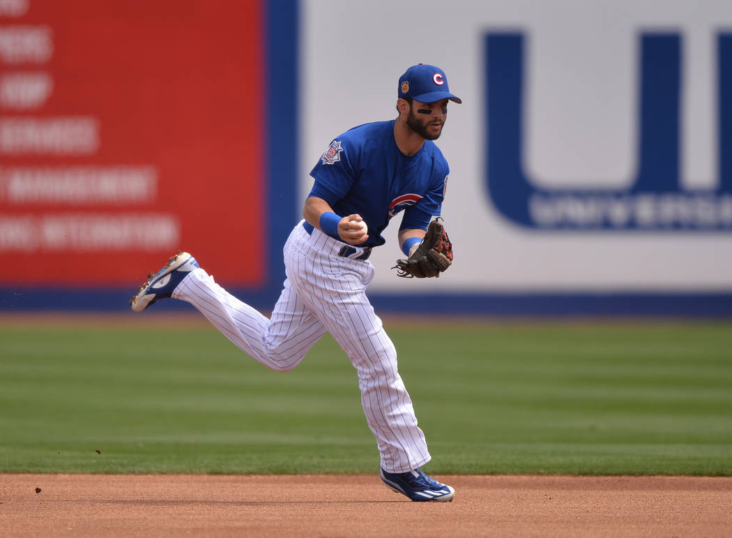 Chicago Cubs second baseman Tommy La Stella (2) fields a ground ball during a game between the Chicago Cubs and the Cincinnati Reds at Cashman Field in Las Vegas on Sunday, March 26, 2017. (Brett  ...