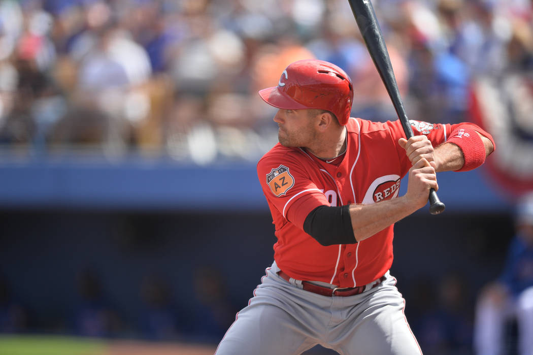 Cincinnati Reds first baseman Joey Votto (19) takes a swing during a game between the Chicago Cubs and the Cincinnati Reds at Cashman Field in Las Vegas on Sunday, March 26, 2017. (Brett Le Blanc/ ...