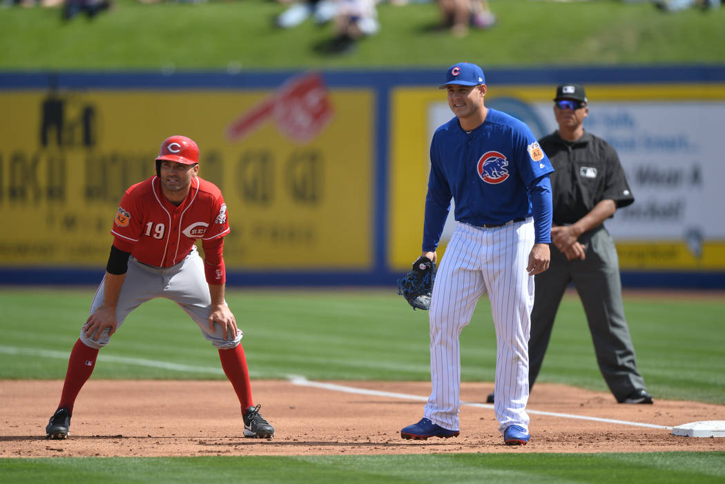 Cincinnati Reds first baseman Joey Votto (19) takes a lead off first base during a game between the Chicago Cubs and the Cincinnati Reds at Cashman Field in Las Vegas on Sunday, March 26, 2017. (B ...