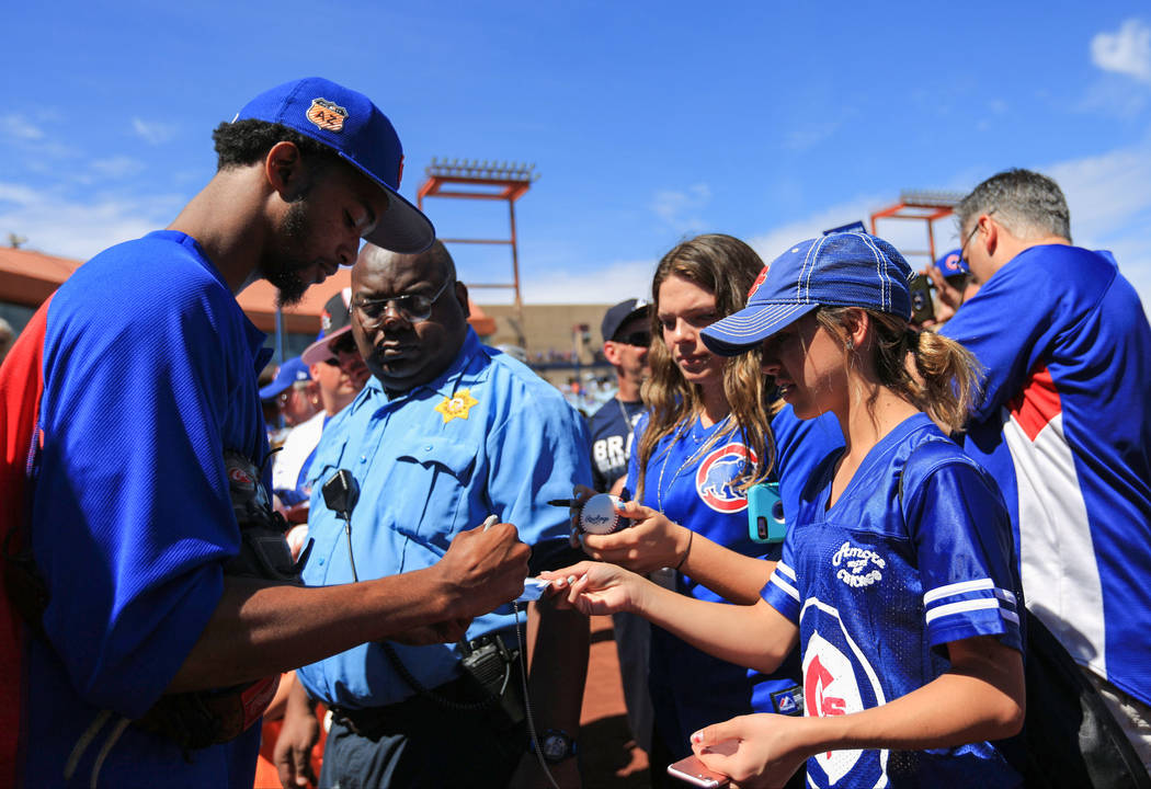 Fans get autographs before a game between the Chicago Cubs and the Cincinnati Reds at Cashman Field in Las Vegas on Sunday, March 26, 2017. (Brett Le Blanc/Las Vegas Review-Journal) @bleblancphoto