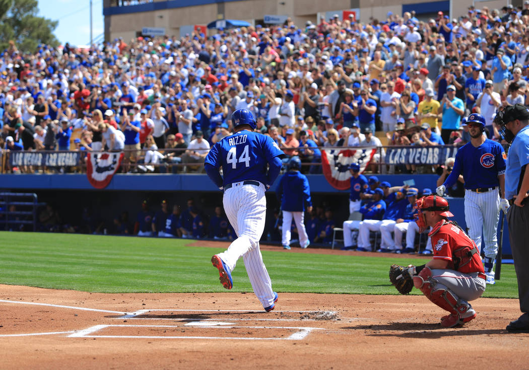 Chicago Cubs first baseman Anthony Rizzo (44) crosses home plate after hitting a home run during a game between the Chicago Cubs and the Cincinnati Reds at Cashman Field in Las Vegas on Sunday, Ma ...