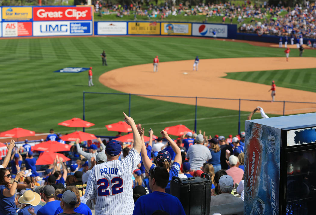 Cubs fans cheer for a home run by Alber Almora Jr. (5) watch a game between the Chicago Cubs and the Cincinnati Reds at Cashman Field in Las Vegas on Sunday, March 26, 2017. (Brett Le Blanc/Las Ve ...