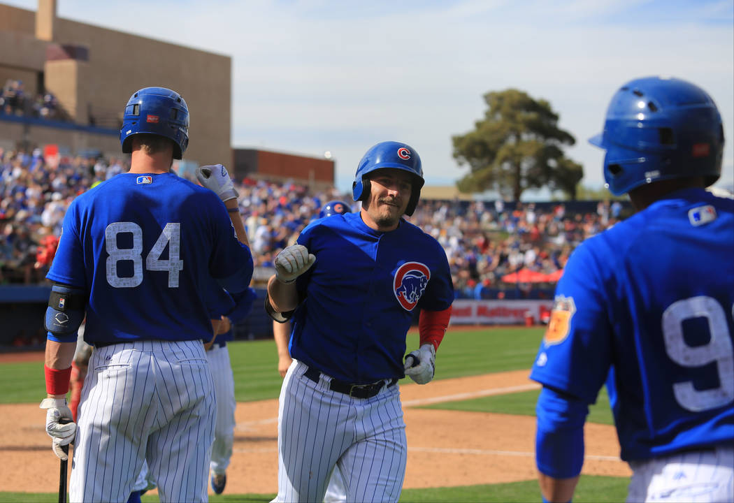 Chicago Cubs outfielder Bijan Rademacher (92) celebrates with his teammates after hitting a grand slam during a game between the Chicago Cubs and the Cincinnati Reds at Cashman Field in Las Vegas  ...