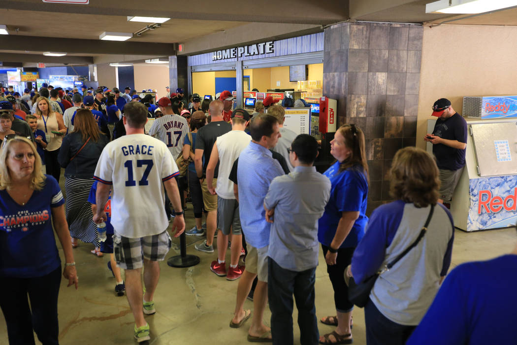 A concession stand line stretches both ways through the concourse, blocking foot traffic during a game between the Chicago Cubs and the Cincinnati Reds at Cashman Field in Las Vegas on Sunday, Mar ...