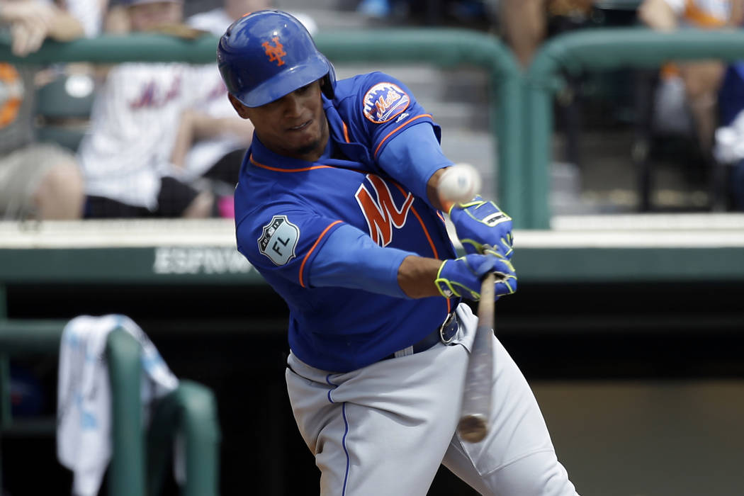 New York Mets' Juan Lagares fouls a pitch in a spring training baseball game against the Atlanta Braves, Saturday, March 25, 2017, in Kissimmee, Fla. (AP Photo/John Raoux)
