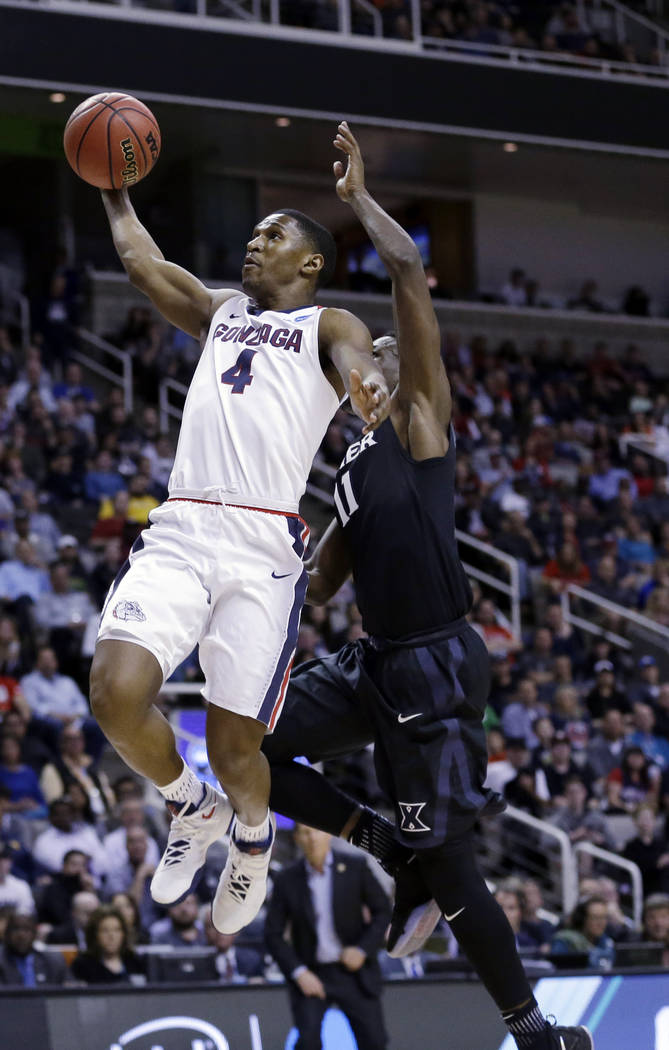 Gonzaga guard Jordan Mathews (4) drives past Xavier guard Malcolm Bernard during the second half of an NCAA Tournament college basketball regional final game Saturday, March 25, 2017, in San Jose, ...