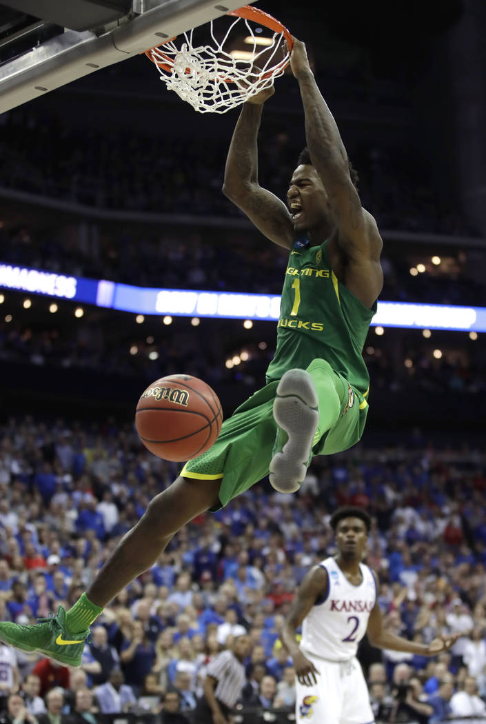 Oregon forward Jordan Bell dunks the ball during the second half of a regional final against Kansas in the NCAA men's college basketball tournament, Saturday, March 25, 2017, in Kansas City, Mo. ( ...