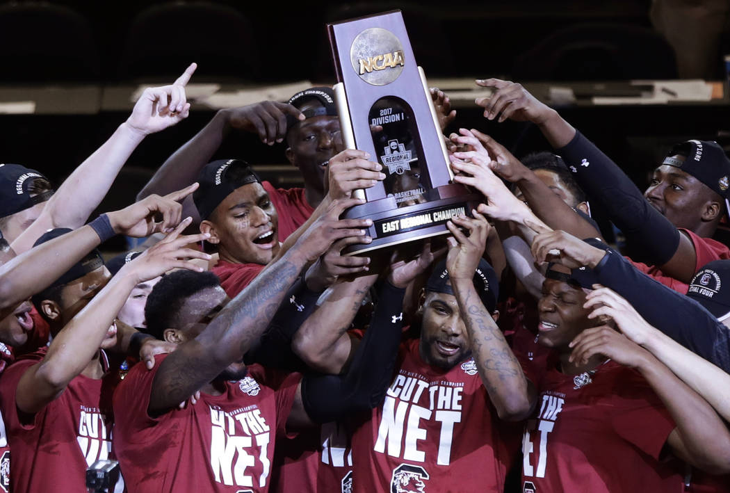 South Carolina players celebrate after beating Florida 77-70 in the East Regional championship game of the NCAA men's college basketball tournament, Sunday, March 26, 2017, in New York. (AP Photo/ ...