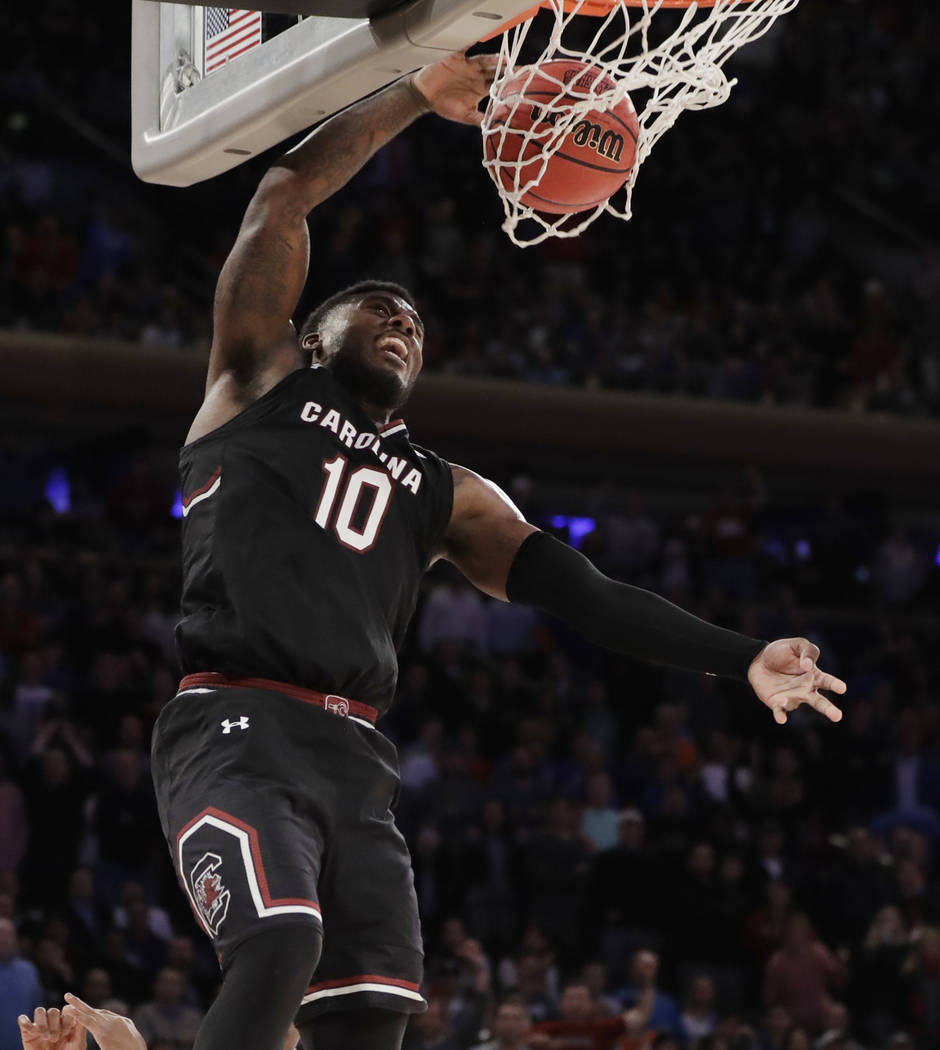 South Carolina guard Duane Notice (10) dunks the ball against Florida during the second half of the East Regional championship game of the NCAA men's college basketball tournament, Sunday, March 2 ...