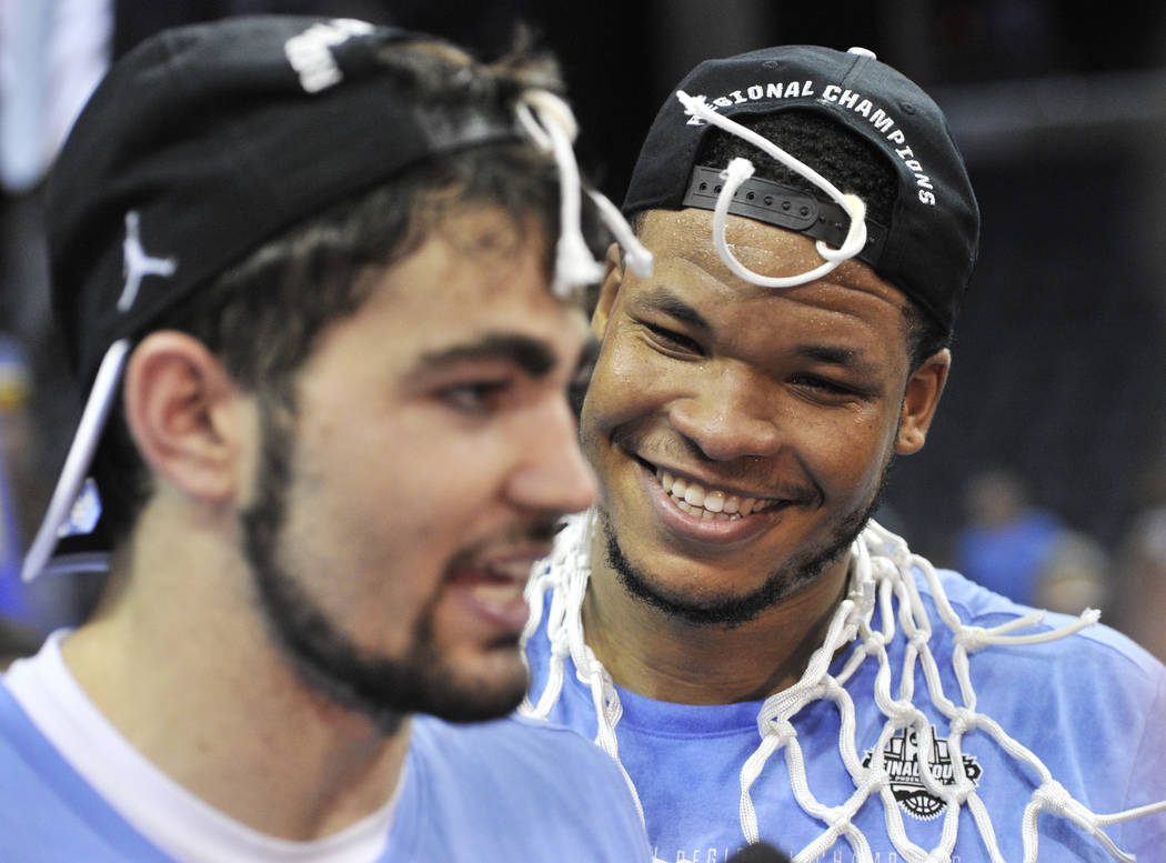 North Carolina's Kennedy Meeks, right, listens as Luke Maye, left, is interviewed after North Carolina beat Kentucky in the South Regional final game in the NCAA college basketball tournament Sund ...