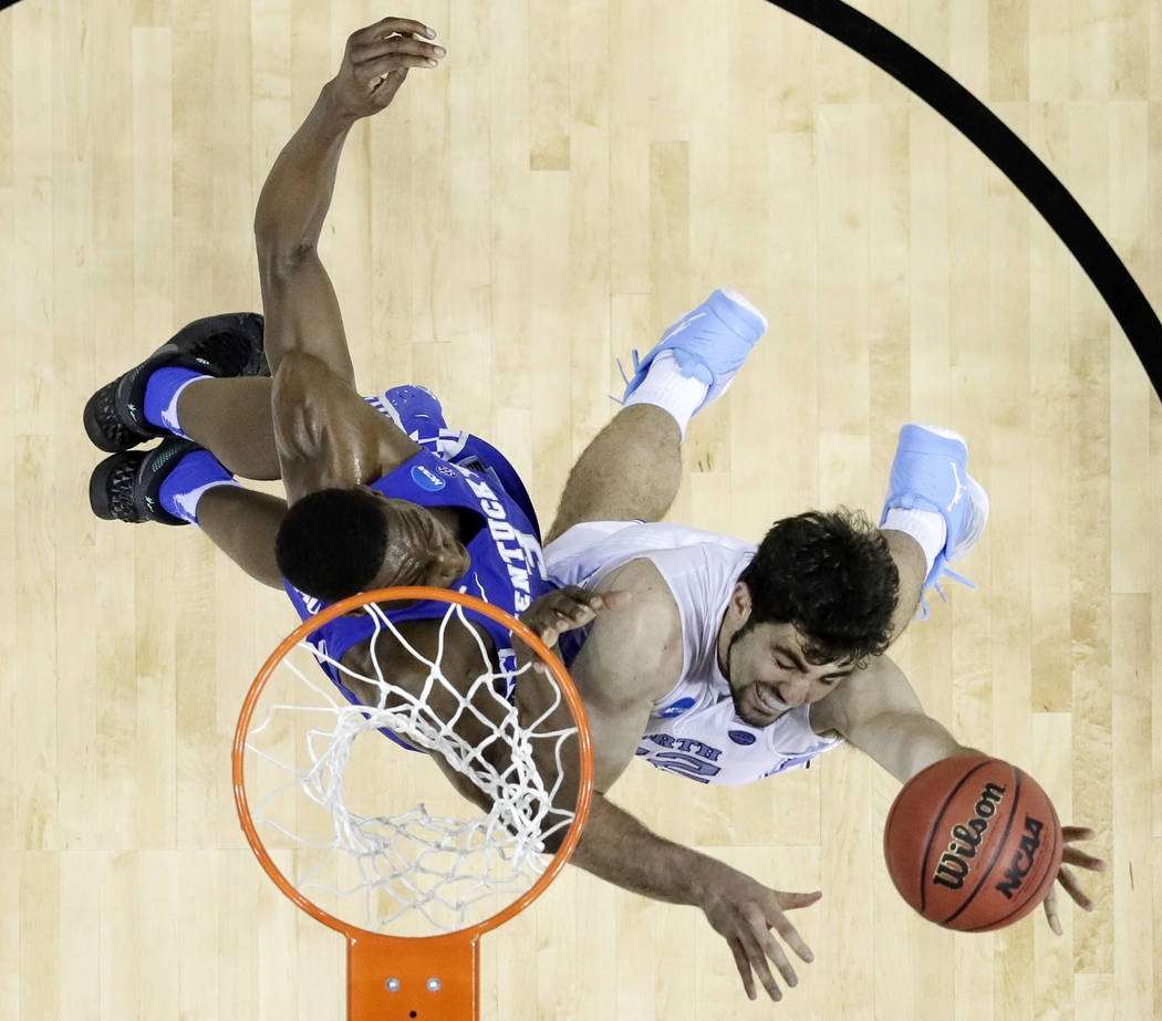North Carolina forward Luke Maye, right, scores against Kentucky's Edrice Adebayo in the second half of the South Regional final game in the NCAA college basketball tournament Sunday, March 26, 20 ...