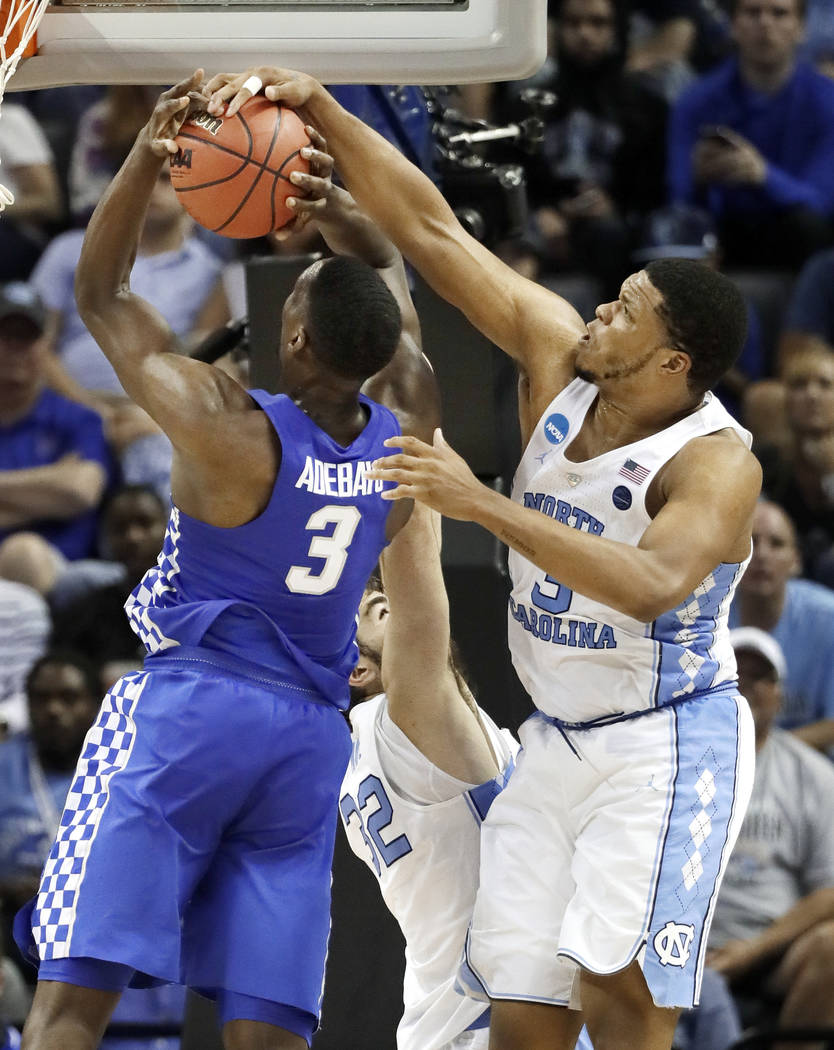 North Carolina forward Kennedy Meeks, right, blocks a shot by Kentucky forward Edrice Adebayo, left, in the second half of the South Regional final game in the NCAA college basketball tournament S ...