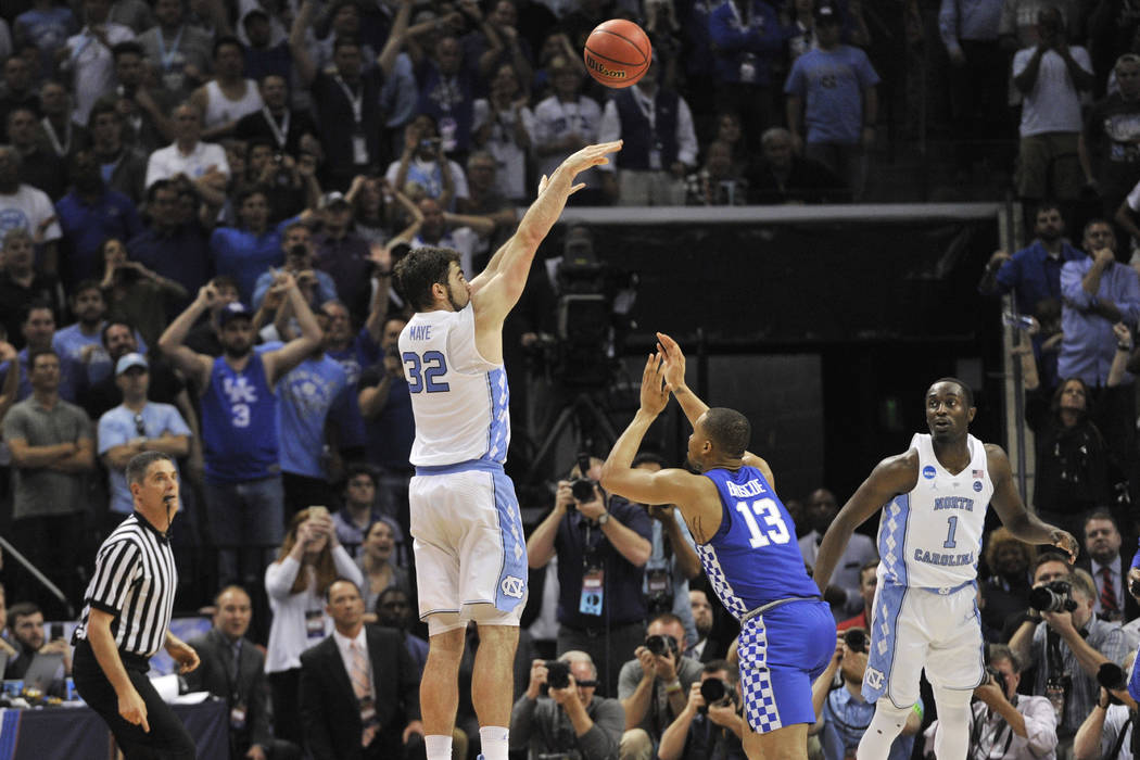 North Carolina forward Luke Maye (32) shoots the winning basket as Kentucky guard Isaiah Briscoe (13) defends in the second half of the South Regional final game in the NCAA college basketball tou ...