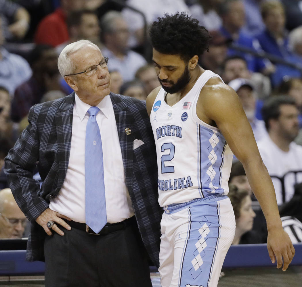 North Carolina head coach Roy Williams speaks with North Carolina guard Joel Berry II (2) in the first half of the South Regional final game in the NCAA college basketball tournament against Kentu ...