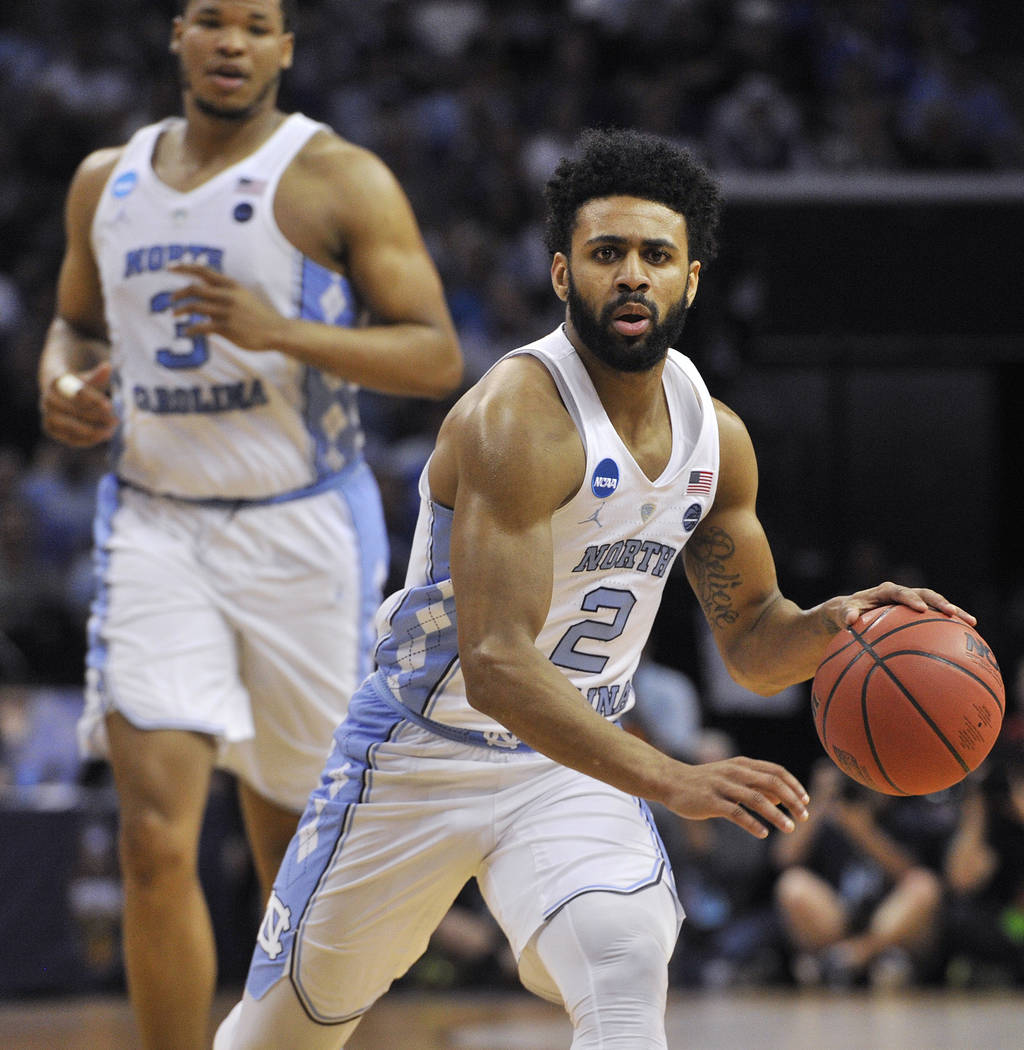 North Carolina guard Joel Berry II (2) drives the ball against Kentucky in the first half of the South Regional final game in the NCAA college basketball tournament Sunday, March 26, 2017, in Memp ...