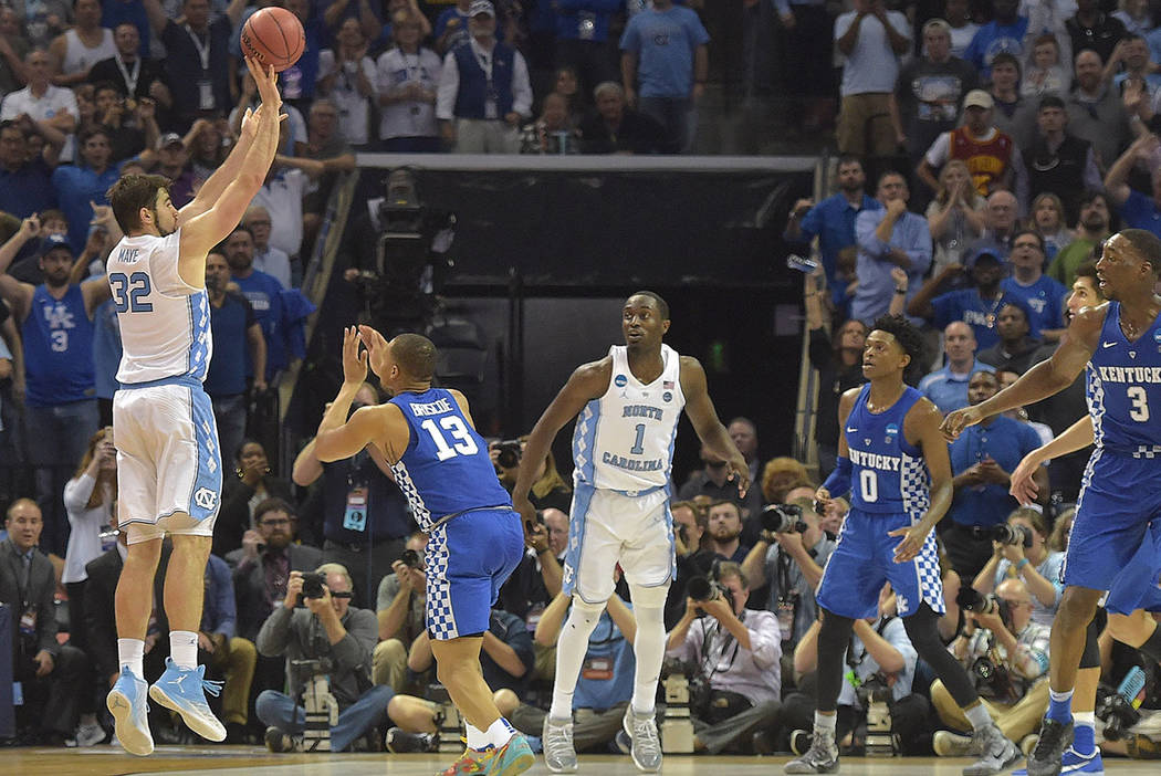 North Carolina Tar Heels forward Luke Maye (32) makes a basket with .3 seconds left over Kentucky Wildcats guard Isaiah Briscoe (13)  in the second half during the finals of the South Regional of  ...