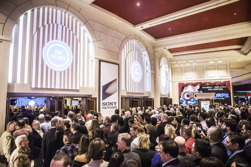 CinemaCon attendees walk through the doors of The Colosseum at Caesars Palace hotel/casino on Monday, March 27, 2017, in Las Vegas. (Benjamin Hager/Las Vegas Review-Journal) @benjaminhphoto