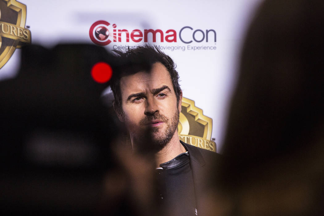 Actor Justin Theroux stops for photos during the Warner Bros. red carpet event at CinemaCon on Wednesday, March 29, 2017, at Caesar's Palace hotel/casino, in Las Vegas. Theroux was there to promot ...