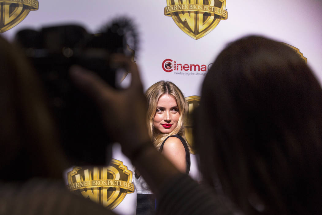 Actress Ana De Armas stops for photos during the Warner Bros. red carpet event at CinemaCon on Wednesday, March 29, 2017, at Caesar's Palace hotel/casino, in Las Vegas. De Armas was there to promo ...