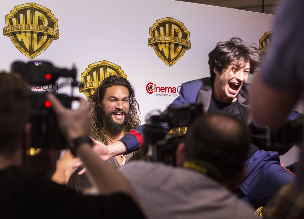 Actors Jason Momoa, left, and Ezra Miller share a laugh during a photo session at the Warner Bros. red carpet event at CinemaCon on Wednesday, March 29, 2017, at Caesar's Palace hotel/casino, in L ...