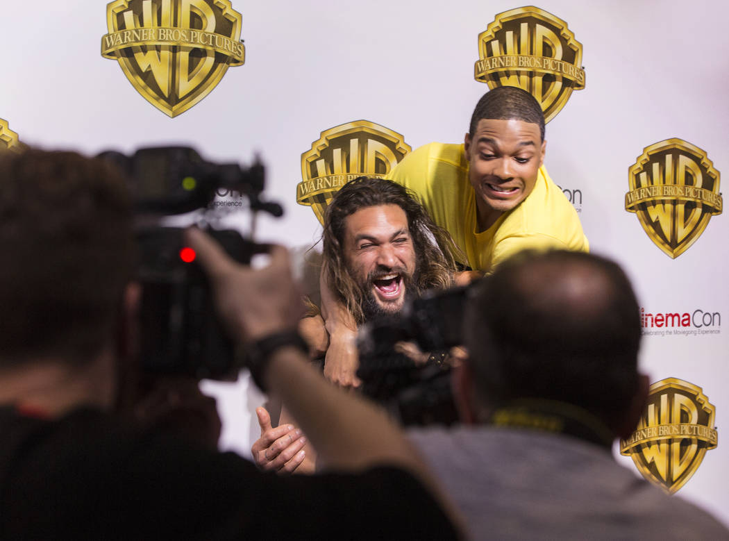 Actors Jason Momoa, left, and Ray Fisher joke around during a photo session at the Warner Bros. red carpet event at CinemaCon on Wednesday, March 29, 2017, at Caesar's Palace hotel/casino, in Las  ...