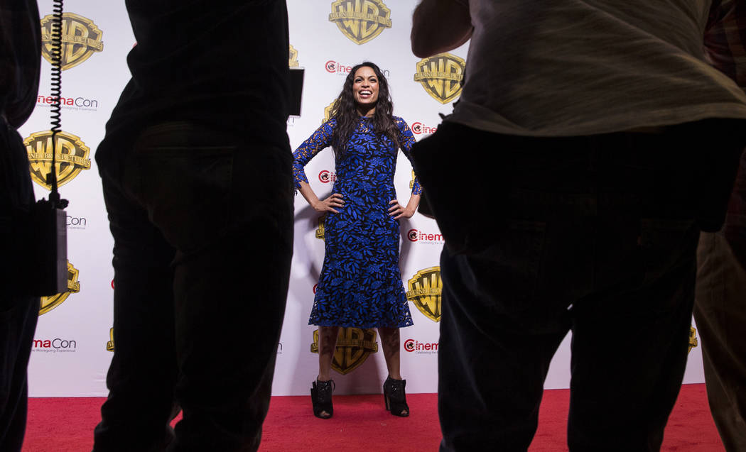 Actress Rosario Dawson shares a laugh with photographers during the Warner Bros. red carpet event at CinemaCon on Wednesday, March 29, 2017, at Caesar's Palace hotel/casino, in Las Vegas. Dawson w ...