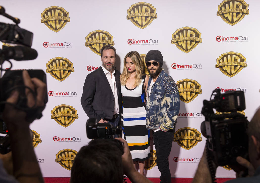 Director Denis Villeneuve, left, Ana De Armas and Jared Leto stop for photos during the Warner Bros. red carpet event at CinemaCon on Wednesday, March 29, 2017, at Caesar's Palace hotel/casino, in ...