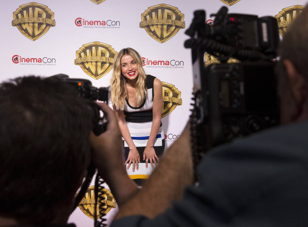 Actress Ana De Armas shares a laugh with photographers  during the Warner Bros. red carpet event at CinemaCon on Wednesday, March 29, 2017, at Caesar's Palace hotel/casino, in Las Vegas. De Armas  ...