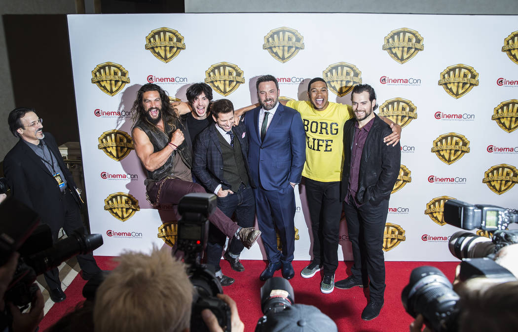 Jason Momoa, left, Ezra Miller, Zack Snyder, Ben Affleck, Ray Fisher and Henry Cavill joke around during a photo session at the Warner Bros. red carpet event at CinemaCon on Wednesday, March 29, 2 ...