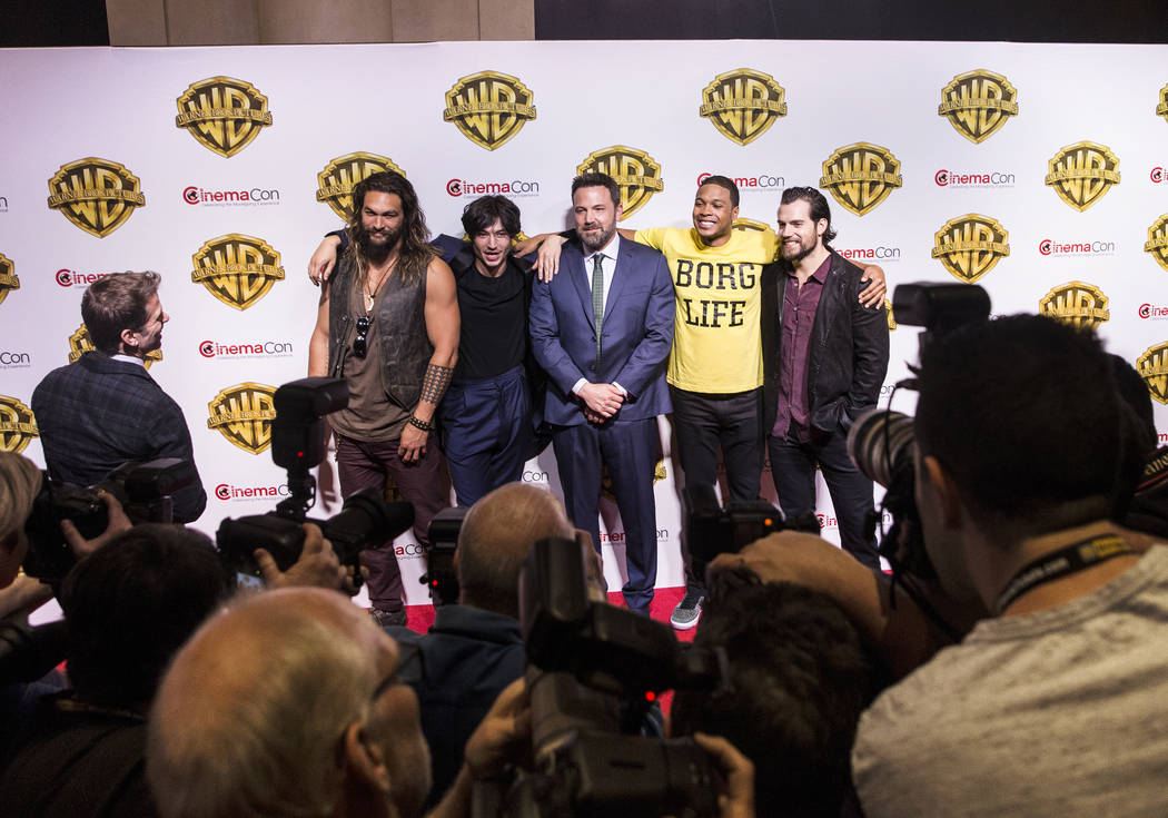 Actors Jason Momoa, left, Ezra Miller, Ben Affleck, Ray Fisher and Henry Cavill joke around during a photo session at the Warner Bros. red carpet event at CinemaCon on Wednesday, March 29, 2017, a ...