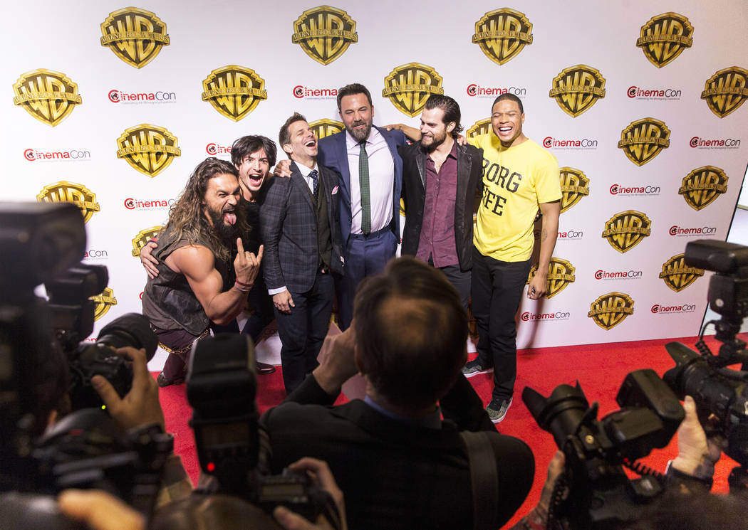 Jason Momoa, left, Ezra Miller, Zack Snyder, Ben Affleck, Henry Cavill and Ray Fisher joke around during a photo session at the Warner Bros. red carpet event at CinemaCon on Wednesday, March 29, 2 ...