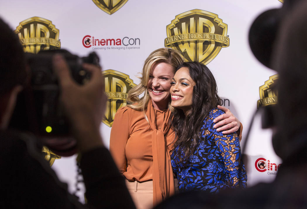 Actresses Katherine Heigl, left, and Rosario Dawson pose for photos during the Warner Bros. red carpet event at CinemaCon on Wednesday, March 29, 2017, at Caesar's Palace hotel/casino, in Las Vega ...
