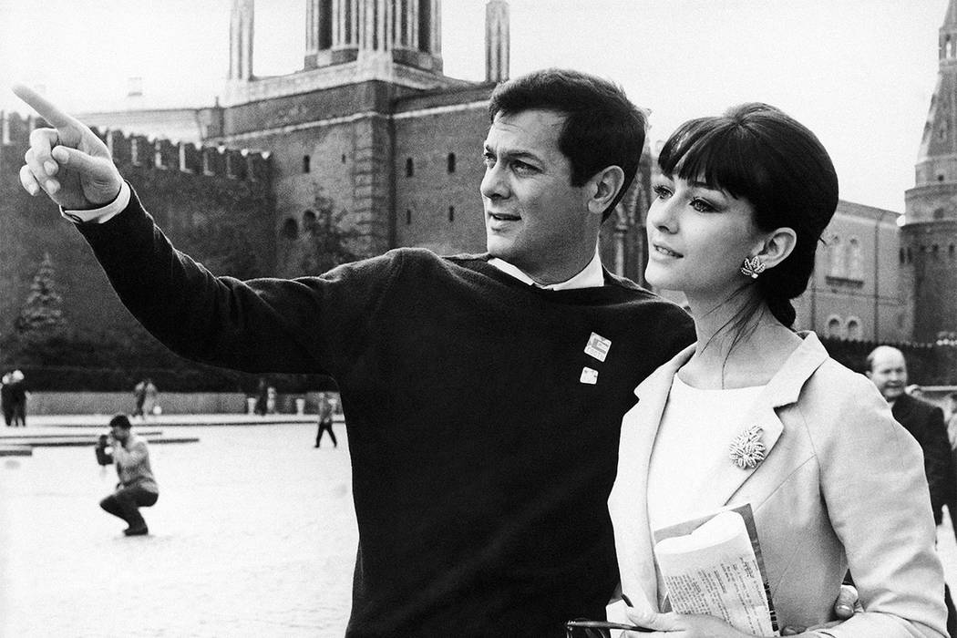 FILE - In this July 11, 1963 file photo US actor Tony Curtis and his German-born wife, actress Christine Kaufmann stroll at the Red Square in Moscow, Soviet Union, during the third International M ...
