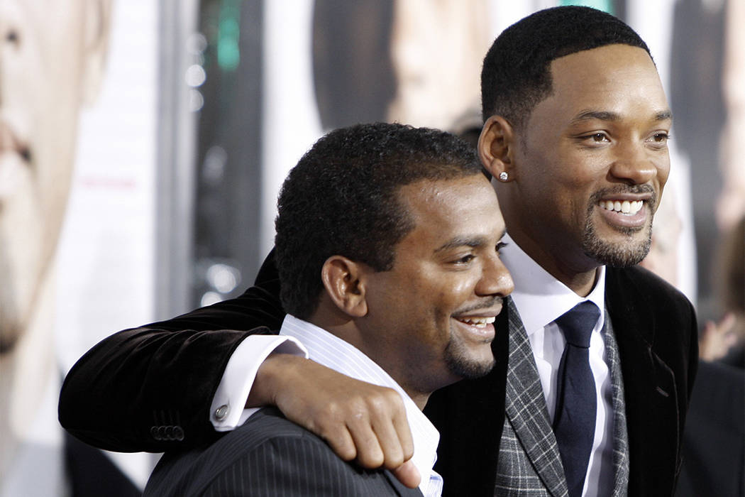 """In this Dec. 16, 2008, file photo, Will Smith, right, and Alfonso Ribeiro pose together at the premiere of """"Seven Pounds"""" in Los Angeles. Ribeiro posted a picture of himself with Smith and their """" ..."""