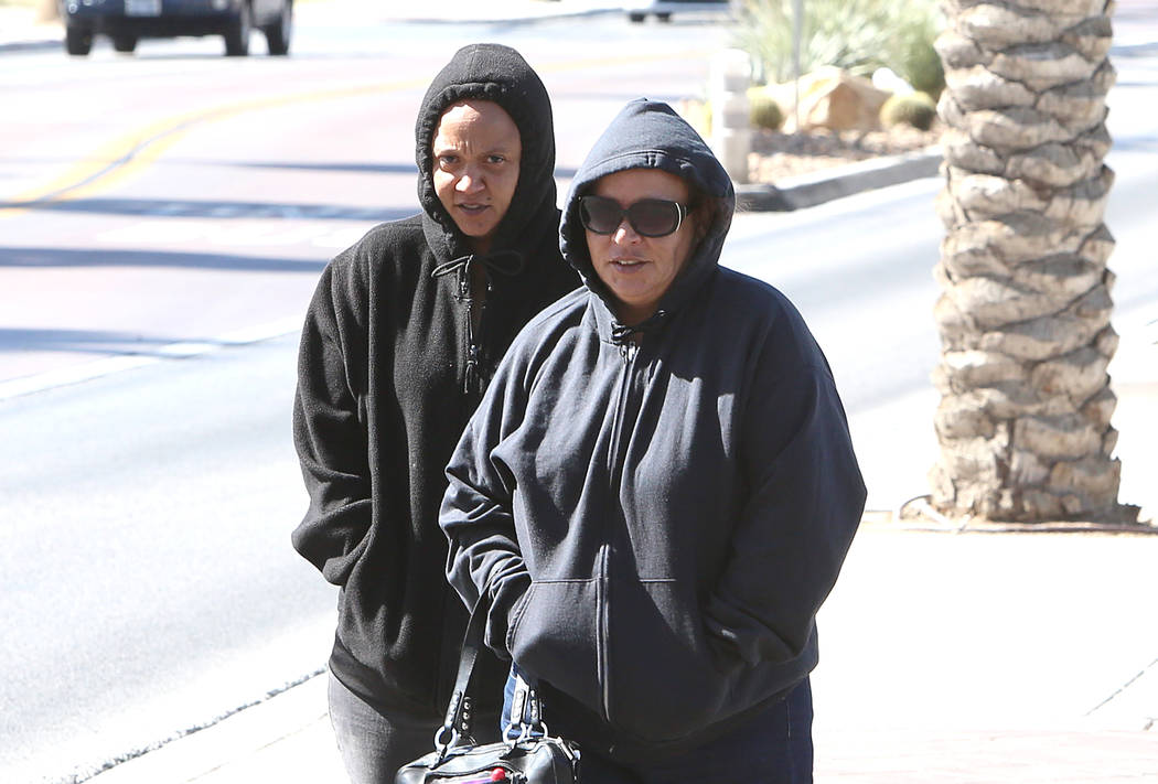 Bundled-up pedestrians cross Gass Avenue on Tuesday, March 28, 201, in Las Vegas. Twenty to 30 mph winds with gusts up to 40 mph are expected in the morning. (Bizuayehu Tesfaye/Las Vegas Review-Jo ...