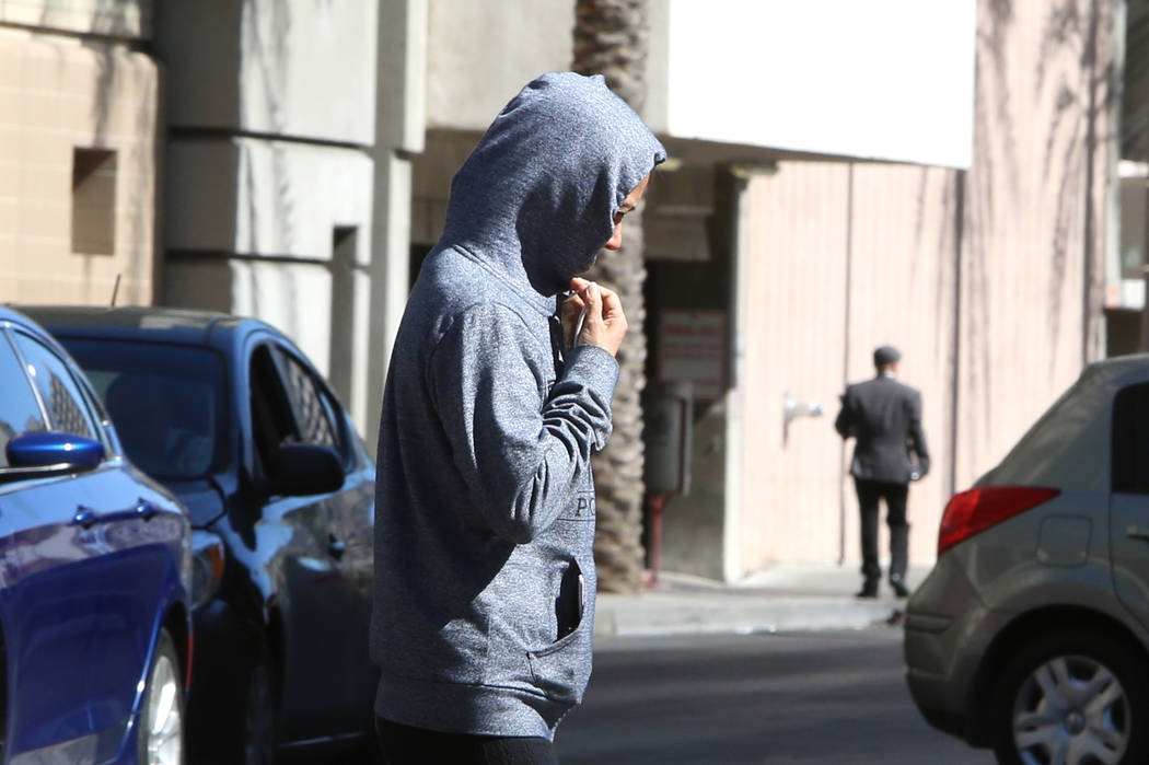 A bundled-up pedestrian crosses Casino Center Boulevard on Tuesday, March 28, 201, in Las Vegas. Twenty to 30 mph winds with gusts up to 40 mph are expected in the morning. (Bizuayehu Tesfaye/Las  ...