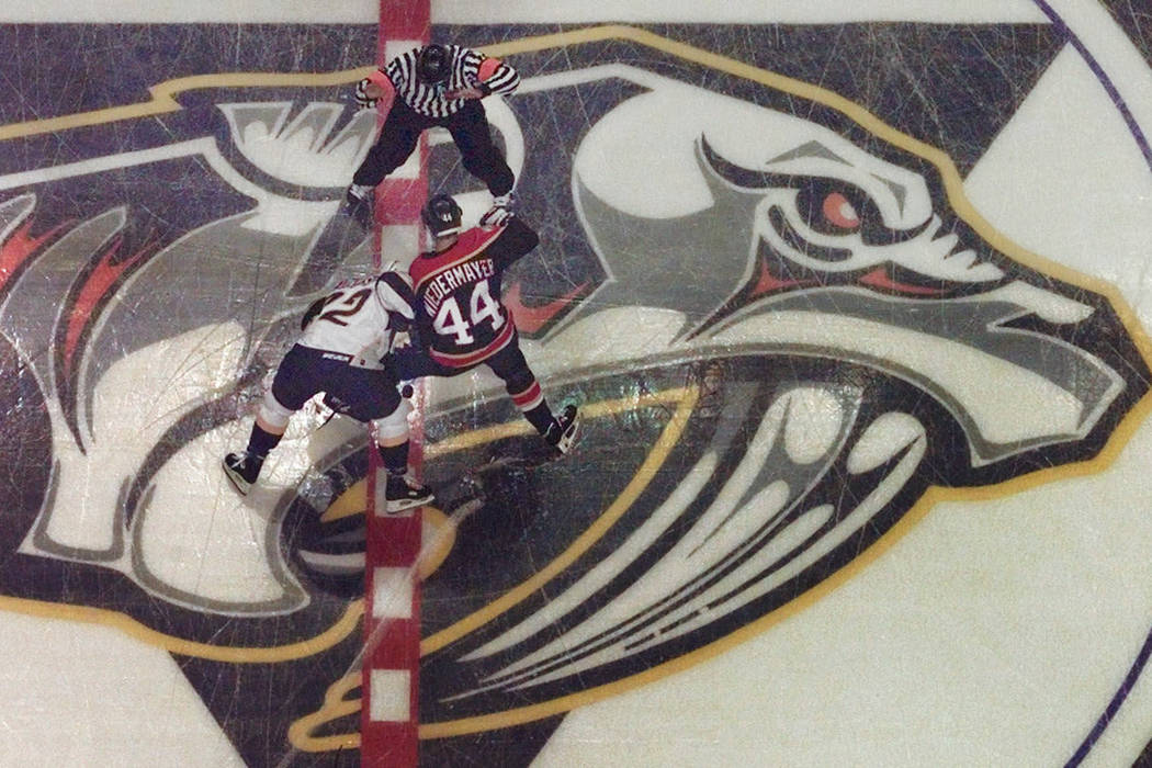 Nashville Predators' Greg Johnson (22) and Florida Panthers' Rob Niedermayer (44) go for the puck in the opening faceoff of the inaugural game for the Predators in Nashville, Tenn., Saturday, Oct. ...