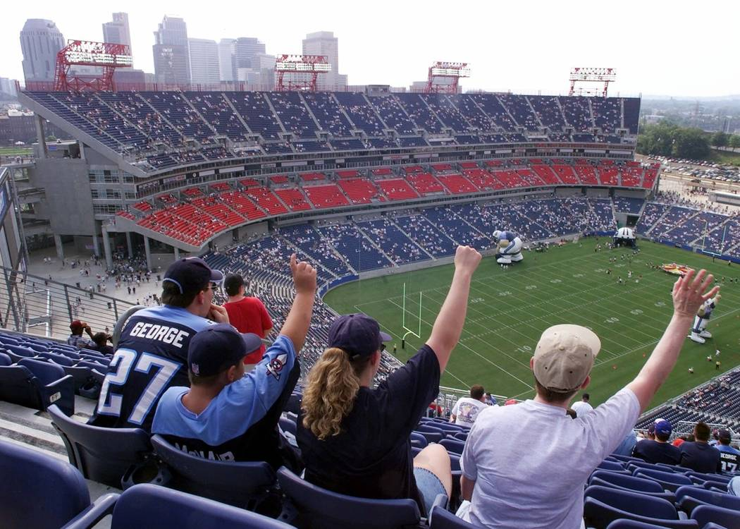 ADVANCE FOR WEEKEND AUG. 21-22--Season-ticket holders attend a practice session in Adelphia Coliseum, the new home of the Tennessee Titans, in Nashville, Tenn., Aug. 7, 1999. The new 67,700-seat s ...