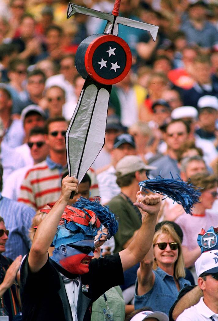Tennessee Titans fan Darren Mackens yells during the Titans' win over the Cincinnati Bengals on Sept. 12, 1999 at Adelphia Coliseum in Nashville, Tenn. After playing before small and sometimes unf ...
