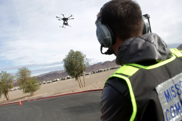 Brett Kanda monitors a drone landing at an event to break ground on Nevada's first unmanned aerial systems urban test site on Wednesday, Jan. 4, 2016, at Nevada State College in Henderson. (Rachel ...