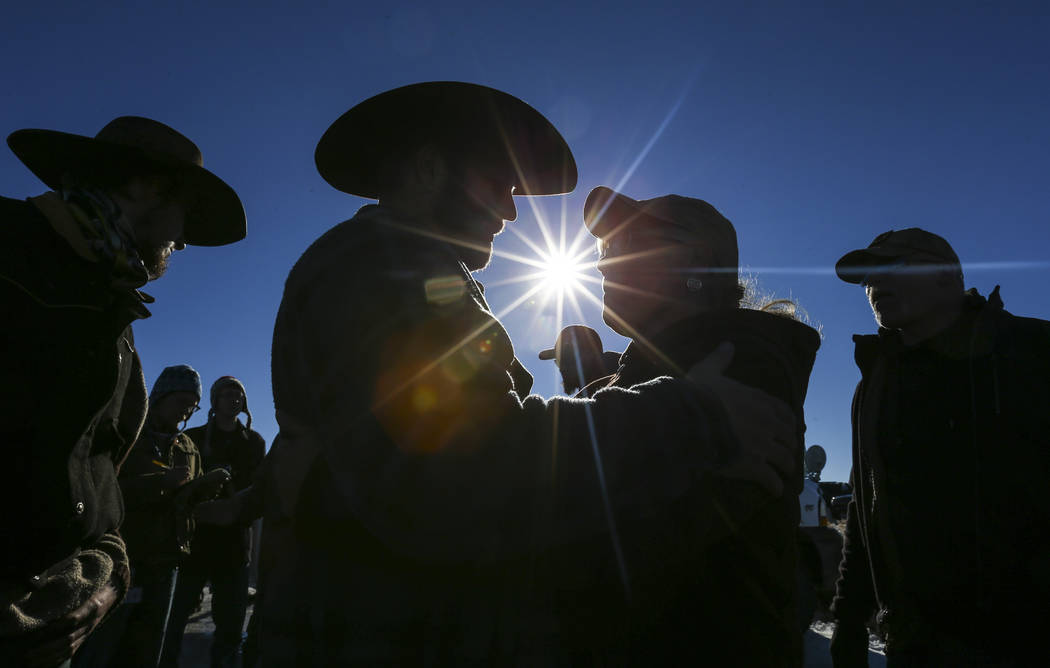 Ammon Bundy, center left, greets supporter Sandy Potter of Crane, Ore. by the entrance of Malheur National Wildlife Refuge headquarters near Burns, Ore. on Friday, Jan. 8, 2016. Bundy, who is the  ...