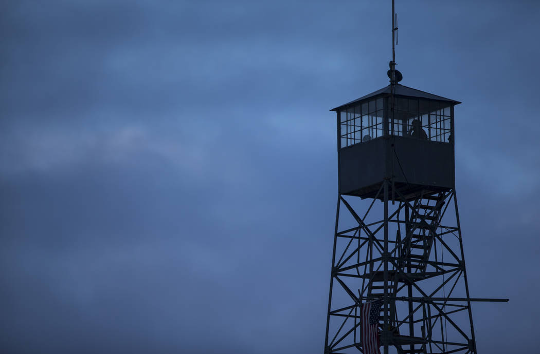 Anti-government protesters stand in a watch tower at the Malheur National Wildlife Refuge headquarters, which the group is occupying, near Burns, Ore. on Thursday, Jan. 7, 2016. The protesters, ma ...