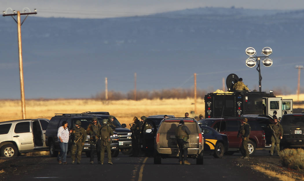 An area resident's vehicle is searched at police roadblock just outside of the Malheur National Wildlife Refuge headquarters, where four anti-government protesters remain, about 30 miles south of  ...