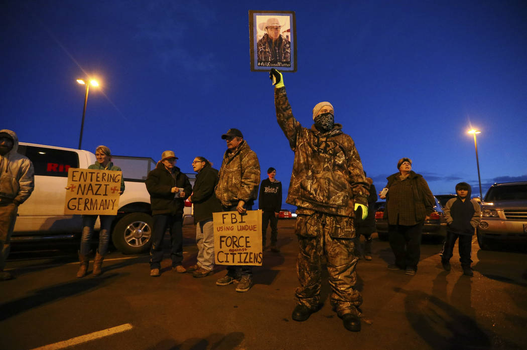 """People gather for a """"rolling"""" protest of the shooting death of LaVoy Finicum, who was killed Tuesday night during an attempted arrest by FBI and Oregon State Police officers, outside of Harney Cou ..."""
